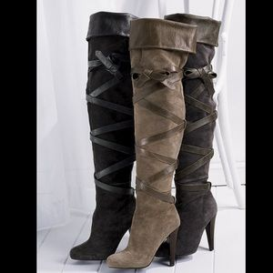 Black thigh high boots with leather straps